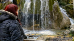 Hiker looking at a mountain waterfall Silver Jets in the forests of Crimea Stock Footage