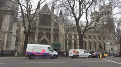 Westminster Abbey church, cars move across building, britain tourism attraction Stock Footage