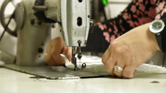 Professional tailor  using sewing machine in workshop Stock Footage