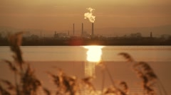 Solar path in the lake with a background of factory chimney Stock Footage