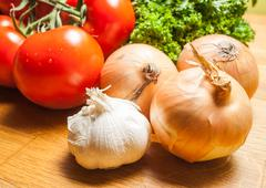 delicious healthy cooking with eggplant tomato garlic and parsley - stock photo