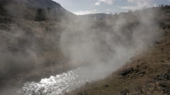 4K - Hot Spring Creek with fumes on a sunny day Stock Footage