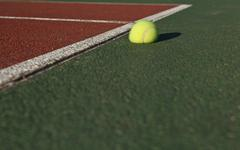 The impact - Tennis ball bouncing off the tennis court - stock photo