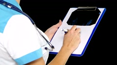 Doctor making notes during therapy session. Alpha channel Stock Footage