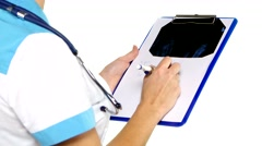 Doctor making notes during therapy session on white background Stock Footage