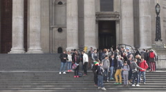 Stock Video Footage of Steady cam shot, tourists wait to visit Saint Paul anglican cathedral, landmark