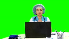 Doctor working at the computer on green screen Stock Footage