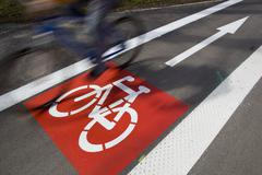 urban traffic concept - bike/cycling lane sign in a city - stock photo