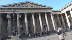 British Museum building, victorian architecture in London UK, tourist visitors - stock footage
