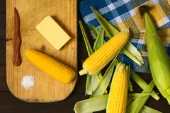 Cobs of Sweet Corn Raw and Cooked Stock Photos