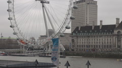 Half of London Eye british symbol UK capital landmark, Thames river flowing slow Stock Footage