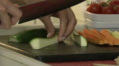 Female hands slicing zucchini  Stock Footage