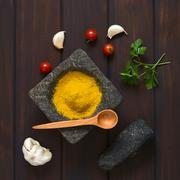 Curry Powder in Mortar - stock photo