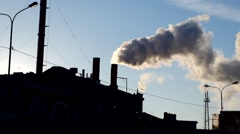 Power plant emissions  during sunrise. Environmental pollution. Factory pipe Stock Footage