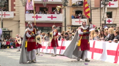 Flag carrier knights on Saint George themed parade Stock Footage