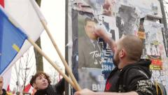 Protesters destroying political advertising  during march in France, Strasbourg - stock footage