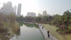 Xuhui park lake with people in Shanghai China. Stock Footage