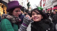St Patricks Festival Dublin Asian Girl having Face Painted Stock Footage
