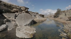 4K Hot Spring Creek with blue sky Stock Footage