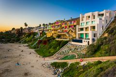 Houses on cliffs above Corona Del Mar State Beach, seen from Inspiration Poin Stock Photos