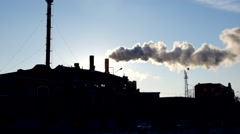 Smoking power plant against sunset sky full HD footage Stock Footage