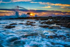 Waves and rocks at sunset, at Little Corona Beach, in Corona del Mar, Califor - stock photo