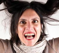 Studio shot of a screaming lady - stock photo
