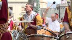 Passionate musicians bang the drums in the parade Stock Footage