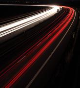 Night highway (Cars in a rush moving fast on a highway (speedwa - stock photo