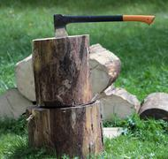 Chopping wood - ax in a log outdoors Stock Photos