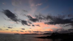 Colorful sunset over Alghero coast Stock Footage