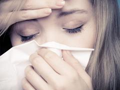 Flu fever. Sick girl sneezing in tissue. Health Stock Photos