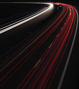 Cars in a rush moving fast on a highway in the UK (speedway) at - stock photo
