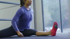 Flexible young woman stretching Stock Footage