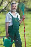Portrait of a gardener in a garden - stock photo