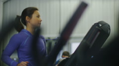 Attractive young woman running on a treadmill in slow motion Stock Footage