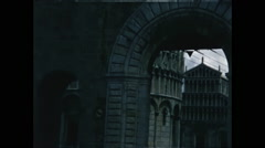 Entering Arch Next to Tower of Pisa Stock Footage