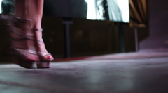 A close up of high heel shoes of the strip dancers on the stage of nightclub - stock footage
