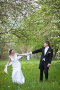 young wedding couple - freshly wed groom and bride posing outdoo - stock photo