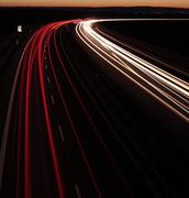 Night highway (Cars in a rush moving fast on a highway  (speedwa Stock Photos