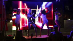 4 hot and sexy PJ dancers on the stage of summer nightclub - stock footage