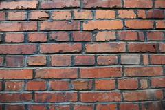 old weathered stained red brick wall background - stock photo