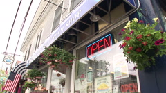 Establishing shot of small shop in Newport Stock Footage