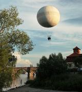 hot air airship above Charles bridge in Prague, Czech republic - stock photo