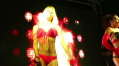 Two sexy striptis dancers on the stage of summer nightclub Stock Footage