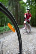 Mountain biking - young active people biking in a forest (shallo Stock Photos
