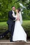 Stock Photo of lovely young wedding couple - freshly wed groom and bride posing