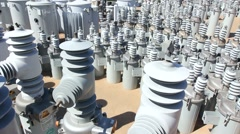 Electric transformers in utility yard Stock Footage