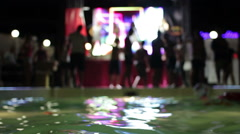 Beautiful and young people dancing at a party near the pool Stock Footage