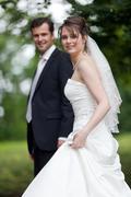 lovely young wedding couple - freshly wed groom and bride posing - stock photo